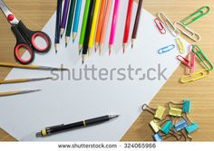 paper on school and frame of colorful school supplies and equipment