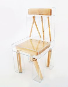 An Exploded Chair Made Using a Wood Chair Disassembled and Sealed Within Clear Acrylic Boxes