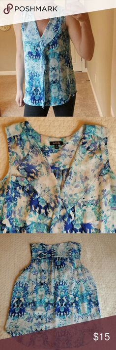 """Silky Floral Blouse Loose fit, comfortable blouse. Great for layering or by itself this summer. Long enough for leggings and looks great with jeans and dress pants too. Two front pockets and ruffle down front. Not sheer. Colors are blues, lavendar, black and white.  28"""" long 21"""" across bust  *Smoke free home *  * 20 % off bundles * Apt. 9 Tops"""