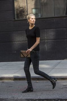 Toni Garrn in a black tee, cheetah print clutch, biker jeans & buckled boots #style Fashion #closed #modeloffduty