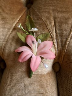 Pink Orchid with Vintage Millinery Boutonniere; Handmade wedding boutonniere made from a vintage pink orchid, leaves, and a sprig of vintage millinery. Very small, for the minimalist.    I can wrap twine or ribbon around the base if requested. Included is a pearl corsage pin.