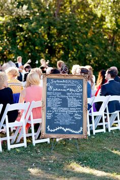 In lieu of paper programs, the couple opted to display the ceremony information on a chalkboard set in a wood frame. #weddingceremony #decor Photography: Jen Lynne Photography. Read More: http://www.insideweddings.com/weddings/a-white-gold-rustic-orchard-wedding-in-illinois/621/