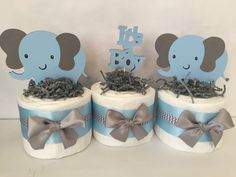 This adorable set of 3 Mini Diaper Cakes would make the perfect decoration at the upcoming Elephant Themed Baby Shower! Elephant Centerpieces include 11 Pampers Swaddlers Diapers per design and measure approx. 6 inches wide by 8 inches tall. Baby Shower Cakes, Elephant Baby Shower Centerpieces, Baby Shower Niño, Shower Bebe, Baby Shower Decorations For Boys, Baby Shower Diapers, Baby Shower Themes, Baby Shower Gifts, Elephant Decorations