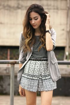 Black and white outfit with a mx of prints in a casual chic look, wearing Adidas Superstar sneakers and blazer.