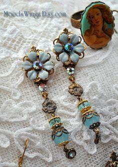 Long pastel blue flower blossom earrings in by MoodsWingz on Etsy