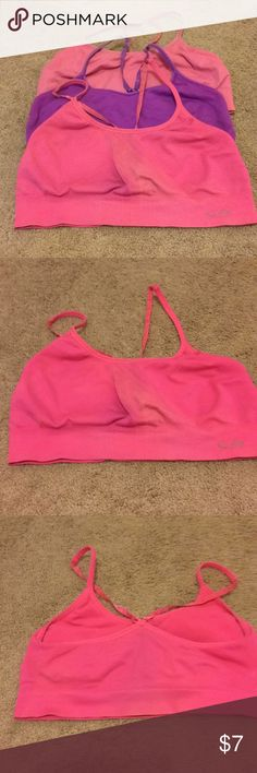 Champion sports bras, size large 3 large sports bras Champion Adjustable straps Selling cheap as they are worn but still work great! Worn—some fading at waist line (see pics) Champion Intimates & Sleepwear Bras