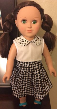 American Girl doll dress. From the School Girl Collection. Black and white, short sleeve dress with music note detail and hounds tooth skater skirt.