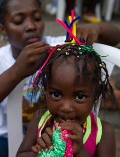 A girl gets an Afro-Colombian hairstyle during the 9th contest of Afro-hairdressers, in Cali, Valle del Cauca departament, Colombia, on May 12, 2013. The Afro hairstyles have their origins in the time of slavery, when women sat to comb their children hair after work. (Photo by Luis Robayo/AFP Photo) http://avaxnews.net/appealing/The_9th_Contest_of_Afro-hairdressers.html #avaxnews.net