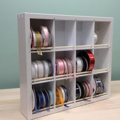 Quickly and easily remove any ribbon spool from the Ribbon Organizer without having to remove others (no dowels to remove and other spools won't unwind when you remove one)! Removing a ribbon spool is