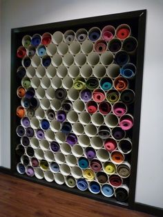 Yoga mat storage with PVC. Perhaps vertical around perimeter of room.