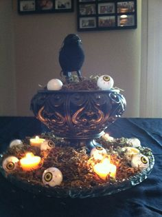 Raven, eyeball, and moss centerpiece.  A few battery operated 'candles' make it extra dramatic!