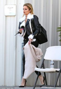 New Year, new attitude: Khloe Kardashian, pictured leaving a studio in Los Angeles on Frid...