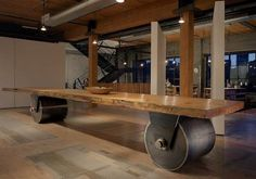 The 26 foot long table is made from a slab of old growth doug Fir felled by the eruption at Mount st. Helens.  The steel rolling wheels were designed by Kundig and forged in Seattle.  I have loved this table since the first time I saw it.