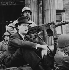 Alfred Krupp, owner and operator of the famous German munitions factory in Essen, Germany, sits on the rear of a jeep which took him from his estate home to division officers for questioning following his capture. April 25, 1945.