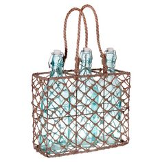 3-piece glass bottle set with a wicker tote.  Product: 1 Basket and 3 bottlesConstruction Material: Glass, ratta...