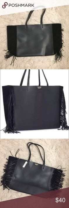NWT Victoria's Secret Fringe tote bag NWT Victoria's Secret Fringe tote bag  Huge! Perfect tote for a day at the beach, a night at a friends or a day out with the kids.  Fun fringe in the side. Front and back are leather-like material and sides are soft suede-like material. Victoria's Secret Bags Totes