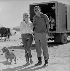 Marilyn with her dog Hugo and an unidentified man on the set of The Misfits, 1960.