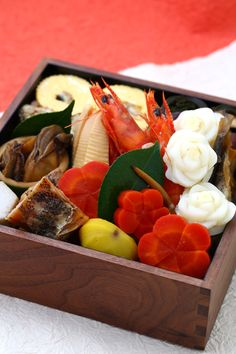 【Osechi-ryori】 Osechi-ryori are specially-prepared New Year's dishes to be eaten during the first three days of January. Most dishes are cooked in order to be preserved for at least three days so women don't have to cook during that period. Various kinds of beautifully-prepared dishes are set in four-tiered lacquer boxes.