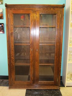 Vintage cabinet with glass doors.