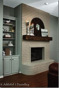 Big dark beam   how to paint brick fireplace | How to Paint a Brick Fireplace - white brick/reclaimed wood mantel