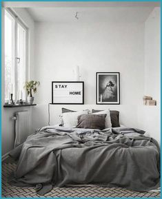 mix Cool and Warm Tones - Minimalist bedroom mixes cool and warm tones. Create tension between custom and warm neutral tones by juxtaposing blue-grays...