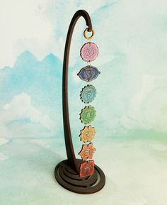 Colorful chakra display perches easily on a desk or can be hung on a wall. Handmade in the USA.
