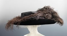 Hat, 1910, silk, feathers, wool With the slimming of the fashionable silhouette in of the second half of the 1900s, hats responded in counterpoint by becoming increasingly larger. The size and form of this hat is impressive, with its wide swath of brim accented with the popular ostrich plumes and its extraordinarily large crown, made to accommodate the large hairstyles of the period.