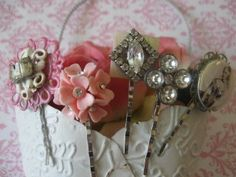 Decorate bobby pins with broken jewelry.  Great idea to add a little something to a hair-do.