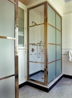 Great use of space with two shower stalls and cabinet in between! In Good Taste: Austin Patterson Disston Architects Frosted Glass Door Bathroom, Bathroom Doors, Glass Shower, Shower Doors, Bathroom Interior, Shower Stalls, Basement Bathroom, Steam Shower Enclosure, Half Walls