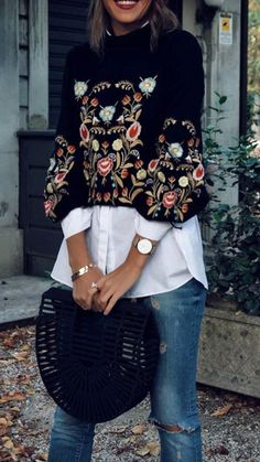 Black sweater / blouse with beautiful embroidery detail over classic white boyfriend shirt and distressed denim jeans