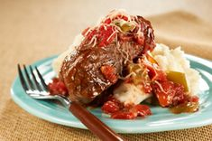 Slow-Cooker Saucy Swiss Steak   You gotta love tomato's!  I would add a can of stewed tomato's and onion!  Just sayin .......................!  Oh yeah, serve with mashed potatoes or baked . . . the sauce makes good gravy!