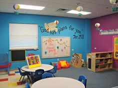 """Bright Preschool Classroom including Hot Air Balloons and Dr. Seuss """"Oh the Places You'll Go"""" theme."""
