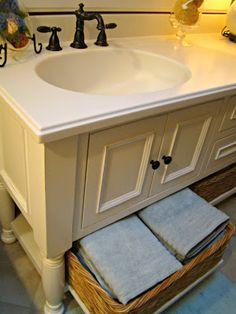 custom made bath vanity painted SW snowbound + corian bisque countertop