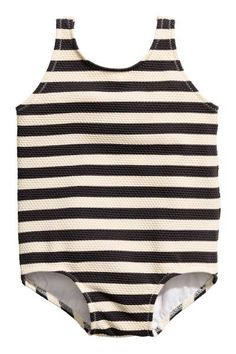 BABY EXCLUSIVE. Fully lined swimsuit with a textured pattern.