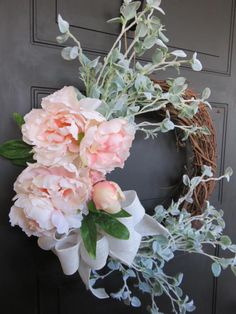 Spring Wreath for Front Door, Wreath for Front Door, Spring Blossoms, Pink Wreath, Peonies Wreath, Large Wreath This beautiful spring wreath is handcrafted with light pink peonies, light greenery and a white burlap bow. It is best to keep this wreath out of the elements. Direct