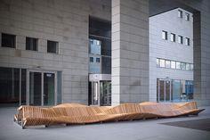 Long Wooden Bench by Piotr Zuraw