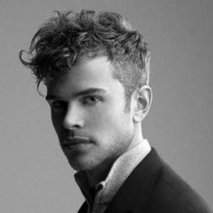 sleek curly hair undercut men