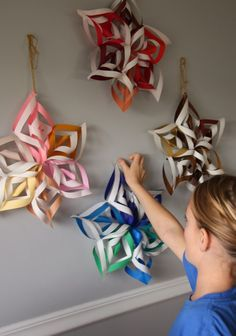 3D paper snowflake project-did these with my daughters whole first grade class, they were so excited to make something so big!