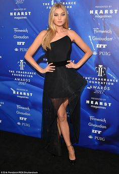 Blonde beauty: Victoria's Secret Angel Elsa Hosk chose a strapless black dress that had a ...