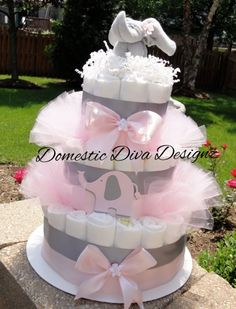 This diaper cake includes the following:  75 Size 1 Pampers Swaddlers Diapers Light Pink Satin Ribbon Gray Satin Chevron Ribbon 1 Light Pink & Gray Elephant Cut Out Light Pink Tule 1 Light Grey Baby Wash Cloth Elephant Favor (2 9x9 ultra plush baby wash cloths)  This adorable cake will arrive wrapped in a high quality cellophane bag tied with gorgeous coordinating ribbon and a beautiful homemade Ingredients note card attached which will list the items on the cake!  If this item is a gift ...