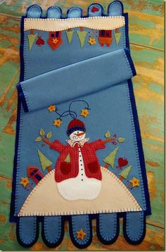 Snowman table runner from wool or felt.  I like the blue background.