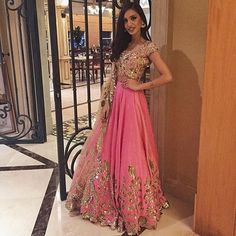 Pink, gold and all things glittery!  Our client looks pretty in pink in her Anushree Reddy ensemble❤️