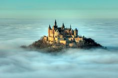 Hohenzollern Castle emerges from dense fog in Hechingen, Germany.
