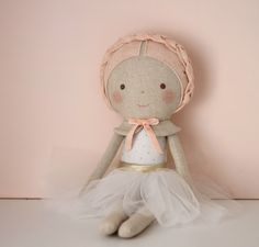 ♥ This dreamy doll is the perfect gift for girls and would look beautiful decorating a childs bedroom. ♥  She comes with a lovely white leotard with gold dots and a white (removable) tutu. Braided hair in soft light pink wool blend felt. Her cape (not removable) has a matching velvet ribbon.  The doll is made with a linen cotton blend fabric and stuffed with fiberfill. Her adorable face is hand embroidered and the cheeks are colored with a child-safe water based pigment.  This heirloom doll…