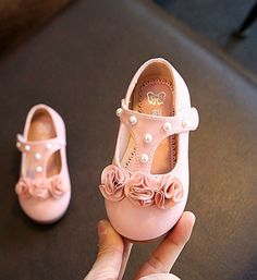 T-Strap Pearl & Flower Shoes--Cute Casual Comfortable Baby/Toddler T-Strap Flower & Pearl Applique Baby Girl Flat Shoes. Available from 1-2 years old. Material: Pu Leather & rubber. Colors: Pink & White. Please choose your little girl size by Insole length