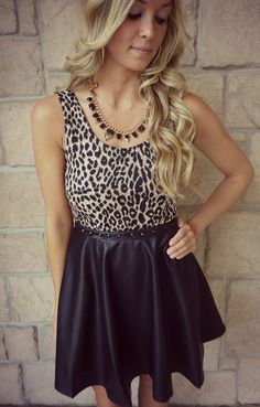 Perfect faux leather and leopard dress! Available at our Peoria, IL location!