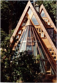 A-frame with a terrific sun room. }}} very impressive double A frame .. money to burn? gads