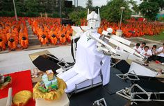 """""""A robot sits before Buddhist monks, as they pray during a mass alms-offering ceremony at King Mongkut's Institute of Technology Ladkrabang in Bangkok, on June 19, 2012. The ceremony was held to mark the 2,600th anniversary of the enlightenment of Lord Buddha.""""  From the extraordinary collection:Robots at Work and Play - In Focus - The Atlantic, via Dan W"""