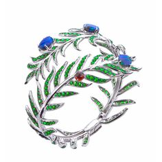 "Katherine Jetter Jewels - ""Lady of the Daintree"" made with sterling silver, tsavorite pave, blue opals and red berry garnets."