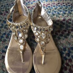 Gold x-cite sandals with jewels Gold flat sandals with ankle wrap and zipper up the back.  Gold jewels decor. Enzo Angiolini Shoes Sandals